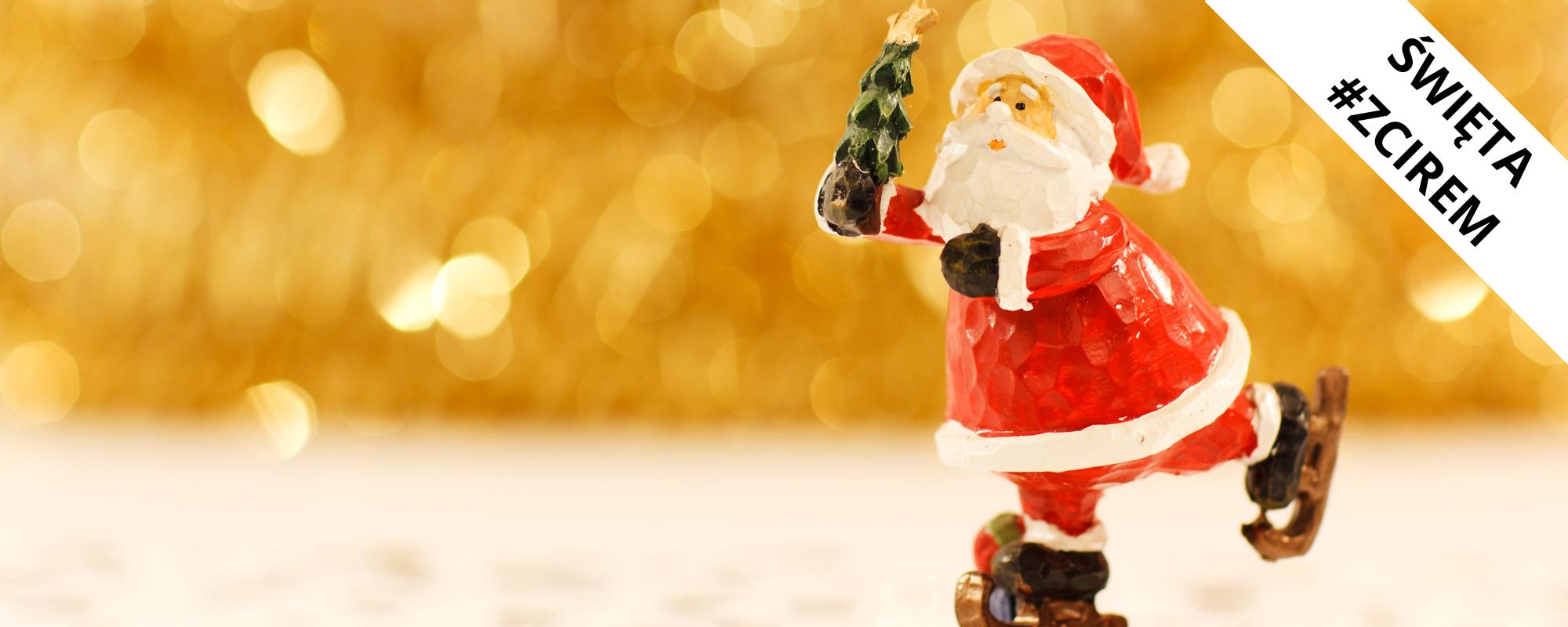 Grafika przedstawia figurkę Świętego Mikołaja na łyżwach
